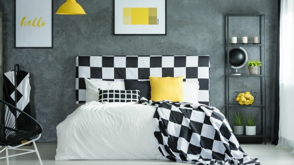 Black and White Bedroom With Pop Of Yellow