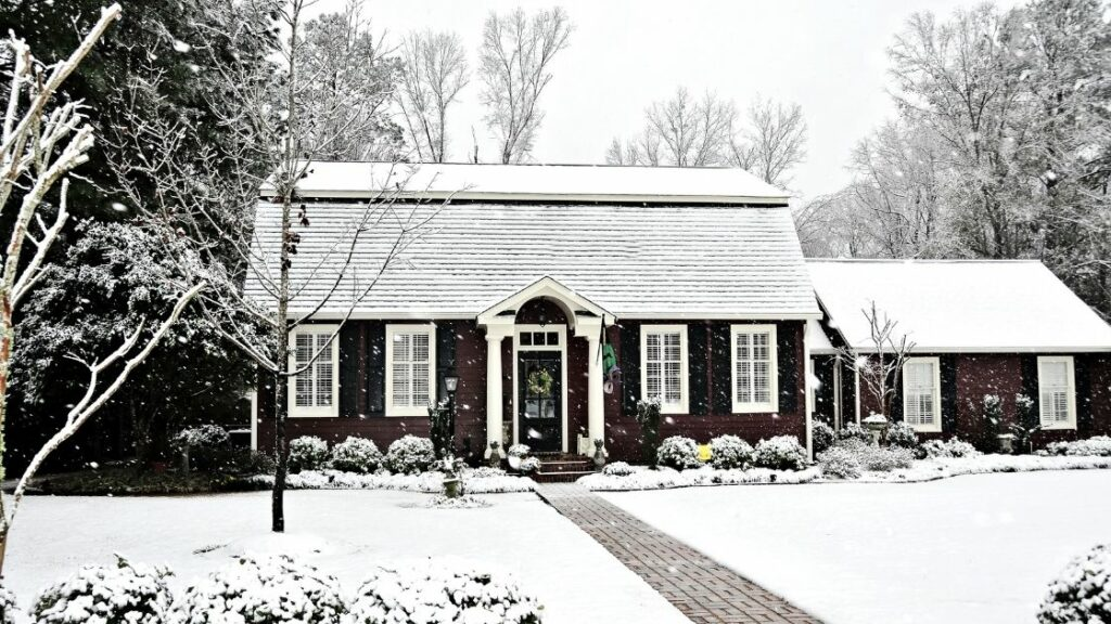 Saltbox Home With Snow